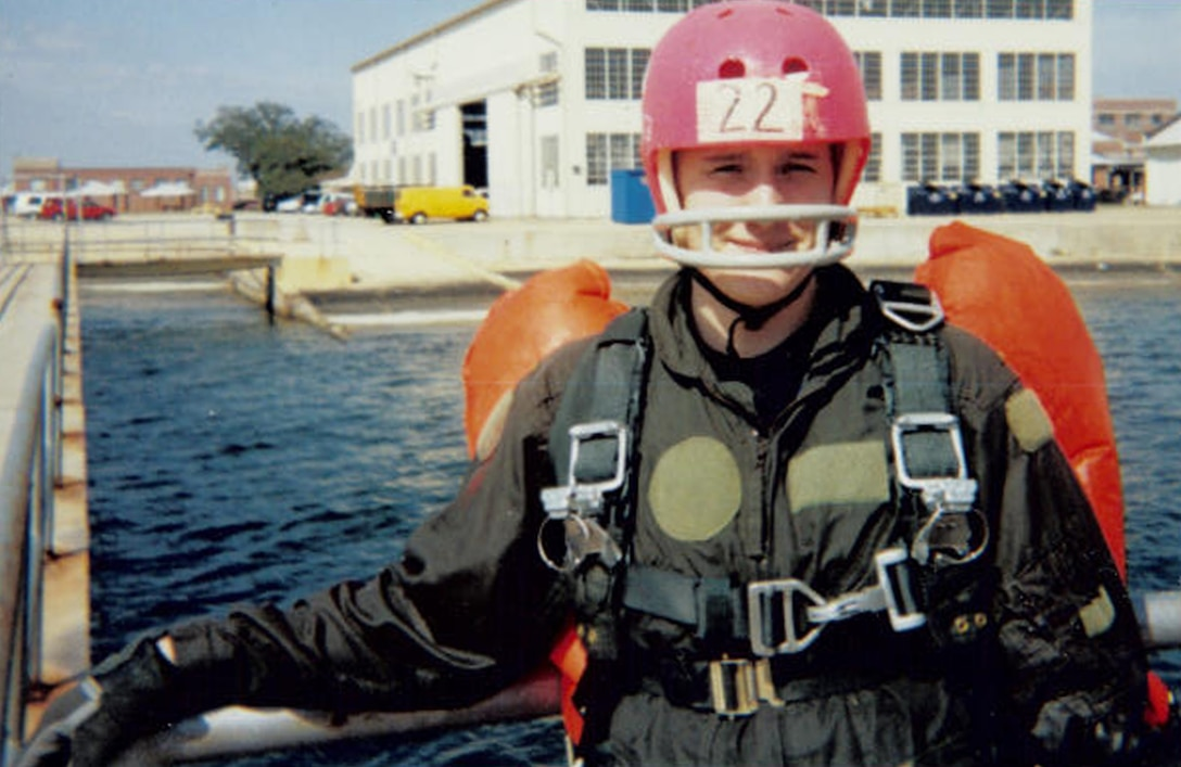 Then Airman Karen Rogers stands on a pier in safety gear for water survival training at Pensacola, Fla. Now a master sgt., Rogers has been a survival, evasion, resistance and escape specialists for 16 years. She is currently one of only five female SERE specialists. (Courtesy photo/Released)
