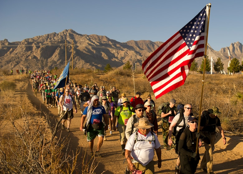 Participants in the Bataan Memorial Death March begin their trek through the sand at White Sands Missile Range, N.M., March 17. The event included both a full 26.2-mile marathon and a 15.2-mile honorary march. More than 5,800 people from across the world participated in the 26.2-mile memorial march to honor the 76,000 prisoners of war who were forced to endure marching nearly 80 miles under brutal conditions during World War II. (U.S. Air Force Photo by Airman 1st Class Michael Shoemaker/Released)