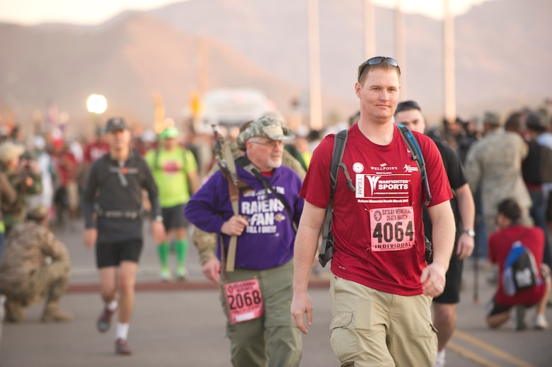 Participants in the Bataan Memorial Death March begin the marathon at White Sands Missile Range, N.M., March 17. The event included both a full 26.2-mile marathon and a 15.2-mile honorary march. More than 5,800 people from across the world participated in the 26.2-mile memorial march to honor the 76,000 prisoners of war who were forced to endure marching nearly 80 miles under brutal conditions during World War II. (U.S. Air Force Photo by Airman 1st Class Michael Shoemaker/Released)
