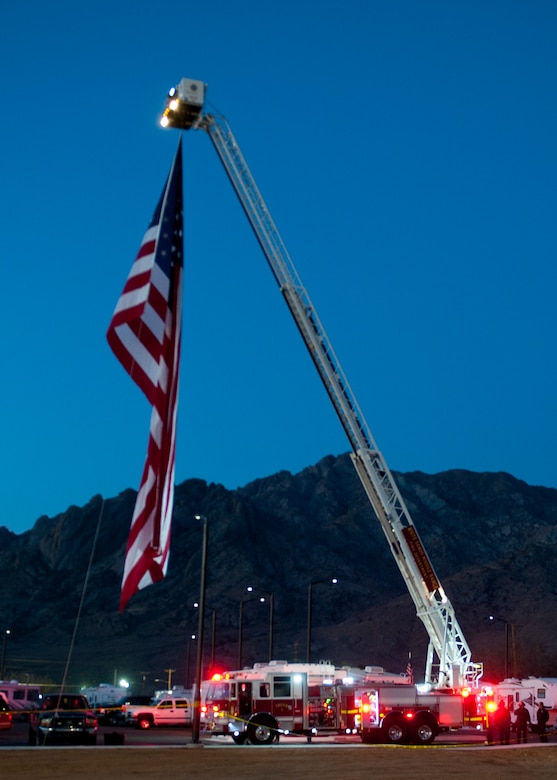 A U.S. flag is raised at the opening ceremony of the 24th annual Bataan Memorial Death March at White Sands Missile Range, N.M., March 17. More than 5,800 people who were from across the world participated in the 26.2-milememorial marathon to honor the 76,000 prisoners of war forced to endure marching nearly 80 miles under brutal conditions during World War II. (U.S.  Air Force photo by Airman 1st Class Daniel E. Liddicoet/Released)