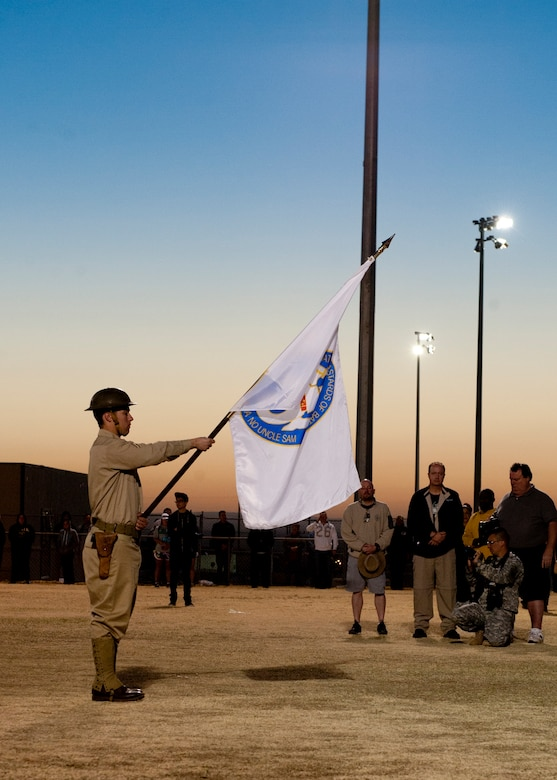 A U.S. Army service member posts the flag of the Battling Bastards of Bataan at the opening ceremony of the 24th annual Bataan Memorial Death March at White Sands Missile Range, N.M., March 17. More than 5,800 people who were from across the world participated in the 26.2-milememorial marathon to honor the 76,000 prisoners of war forced to endure marching nearly 80 miles under brutal conditions during World War II. The event began around 7 a.m., and the course stayed open until 8 p.m., when darkness fell, and it was no longer safe for participants to continue. (U.S.  Air Force photo by Airman 1st Class Daniel E. Liddicoet/Released)
