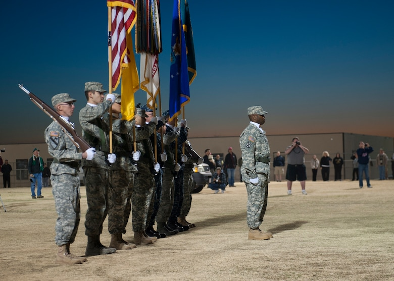 The White Sands Missile Range honor guard posts the colors during the opening ceremony of the 24th annual Bataan Memorial Death March at White Sands Missile Range, N.M., March 17. More than 5,800 people who were from across the world participated in the 26.2-milememorial marathon to honor the 76,000 prisoners of war forced to endure marching nearly 80 miles under brutal conditions during World War II. The event included both a full 26.2-mile marathon and a 15.2-mile honorary march. (U.S.  Air Force photo by Airman 1st Class Daniel E. Liddicoet/Released)