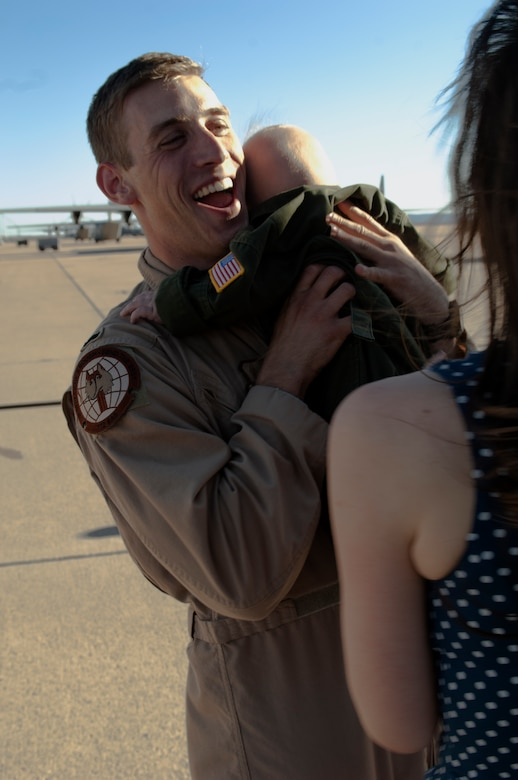 1st Lt. Zacharee Arendsee, 40th Airlift Squadron, hugs his infant son Sam after returning from a three month deployment to Southwest Asia March 15, 2013, at Dyess Air Force Base, Texas. For the first time in nearly a decade, the entire 317th Airlift Group fleet is back at their home station. (U.S. Air Force photo by Airman 1st Class Kylsee Wisseman/ Released)