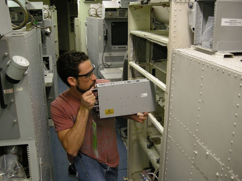 MELBOURNE, Fla. - A contract worker installs equipment for the Multifunctional Distribution Systems Joint Tactical Radio System terminal on a Joint STARS aircraft earlier this year. Joint STARS recently became the first airborne system to fully integrate these new terminals. (Courtesy photo)