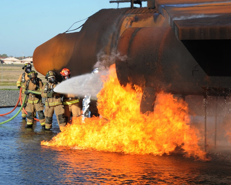 Firefighters from the Shreveport Fire Department extinguish an aircraft fire during a joint training exercise on Barksdale Air Force Base, La., March 15. Barksdale's Fire Department invited Shreveport fire fighters to use their facility and complete their annual aircraft training. (U.S. Air Force photo/Senior Airman Sean Martin)