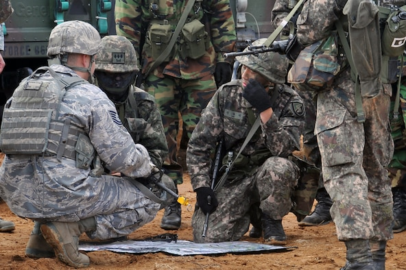 Tech. Sgt. Raymond Cantrell (left), 51st Security Forces Squadron defender, discusses plan of battle with the Republic of Korea Army forces during a ROK Army exercise near Osan Air Base March 15, 2013. Prepositioning of friendly forces to counteract the enemy is key in air base defense operations. (U.S. Air Force photo/Senior Airman Alexis Siekert)
