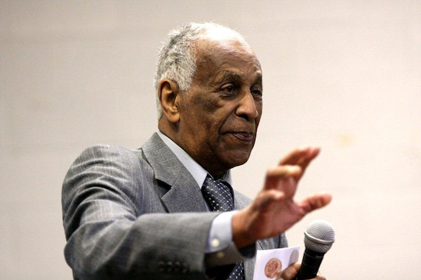 Milton Crenshaw, a Tuskegee airman, makes a point during a presentation at a Black History event.
