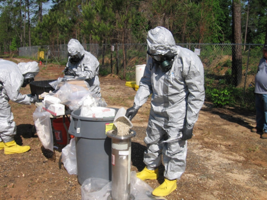 A packaging team conducts a survey prior to a removal action for chemical agent identification sets at Fort Benning, Ga. The Huntsville Center Environmental and Munitoins Center of Expertise provides quality assurance and technical support to Corps offices worldwide in their execution of environmental and munitions response missions like this one.