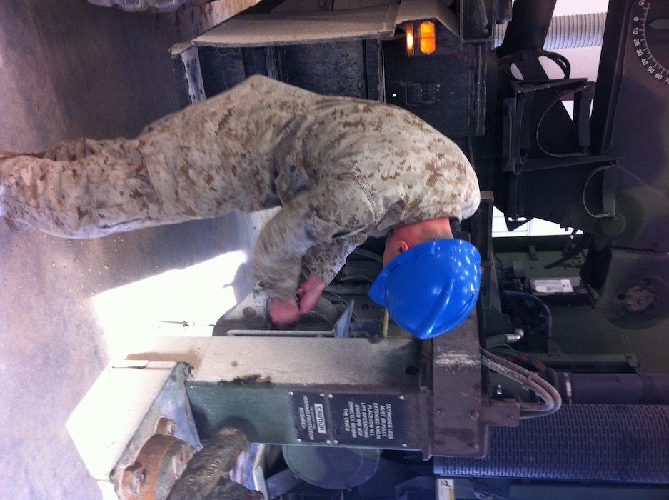 Lance Corporal Stevie R. Mehalic, 1st Radio Battalion practices unstowing and stowing the material handling crane on the AMK36 wrecker at Ft. Leonard Wood, MO while attending Vehicle Recovery Operator Course 3-12. This is one of the first events students learn in the course prior to becoming certified as a 3536 NMOS (Vehicle Recovery Operator).