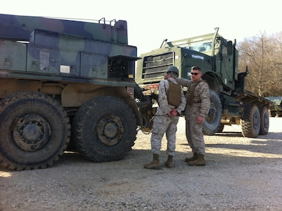 Lance Corporal Micheal T. Morin, CLB-6 is being supervised by Sgt Derick