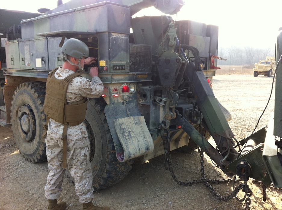 Lance Corporal Micheal T. Morin, CLB-6 is conducting practical application of lifting a towed load with an AMK36 wrecker prior to operating with a towed load at Ft. Leonard Wood, MO while attending Vehicle Recovery Operator Course 3-12. This is one of the first events that students learn in the course prior to becoming certified as a 3536 NMOS (Vehicle Recovery Operator).