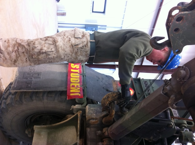 Lance Cpl Jake D. Funk, 1st Battalion 6th Marines practices unstowing and stowing the material handling crane on the AMK36 wrecker at Ft. Leonard Wood, MO while attending Vehicle Recovery Operator Course 3-12.  This is one of the first events students learn in the course prior to becoming certified as a  3536 NMOS (Vehicle Recovery Operator).