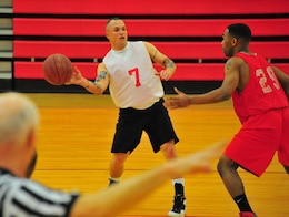 Micheal Martinet, a player for Combat Instructor Weapons' American League intramural basketball team, makes a blind pass to a teammate on March 18, 2013, at Barber Physical Activity Center. MCESG defeated CI WPNS, 66-44.