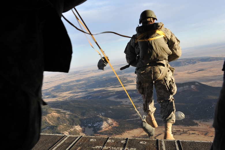A 10th Special Forces Group member parachutes from a CH-47 Chinook for a training mission March 6, 2013, at Fort Carson, Colo. With the assistance of the Colorado Army National Guard Aviation Support Facility members and assets, 10th SFG members parachuted from the Chinook as part of a training mission. (U.S. Air Force photo by Airman 1st Class Riley Johnson/Released)