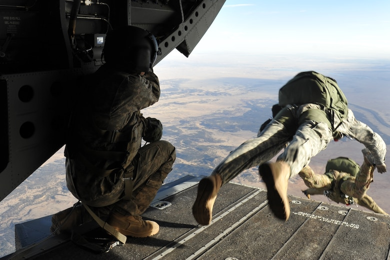 The 10th Special Forces Group members parachute from a CH-47 Chinook for a training mission March 6, 2013, at Fort Carson, Colo. With the assistance of the Colorado Army National Guard Aviation Support Facility members and assets, the Special Forces members performed high altitude low opening parachute jumps from an elevation of 13,000 feet. (U.S. Air Force photo by Airman 1st Class Riley Johnson/Released)