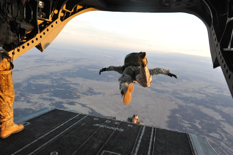 The 10th Special Forces Group members perform a high altitude low opening parachute jump for a training mission March 6, 2013, at Fort Carson, Colo. With the assistance of the Colorado Army National Guard Aviation Support Facility members and assets, the Special Forces members jumped from a CH-47 Chinook at an elevation of 13,000 feet. (U.S. Air Force photo by Airman 1st Class Riley Johnson/Released)