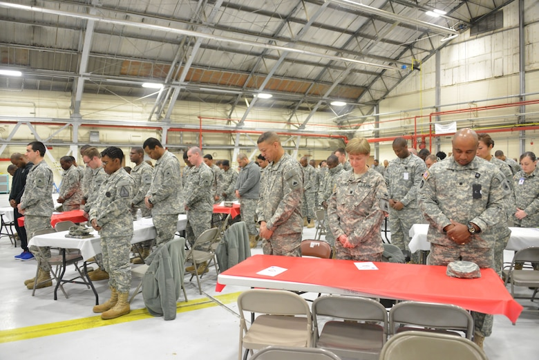 D.C. National Guard members take a moment to reflect in prayer during the Joint National Guard Prayer Breakfast held by the 113th Wing, DCANG.  The breakfast is an annual event held on Joint Base Andrews to emphasize spiritual resiliency within the unit. (U.S. Air Force photo/Master Sgt. Dennis Young)