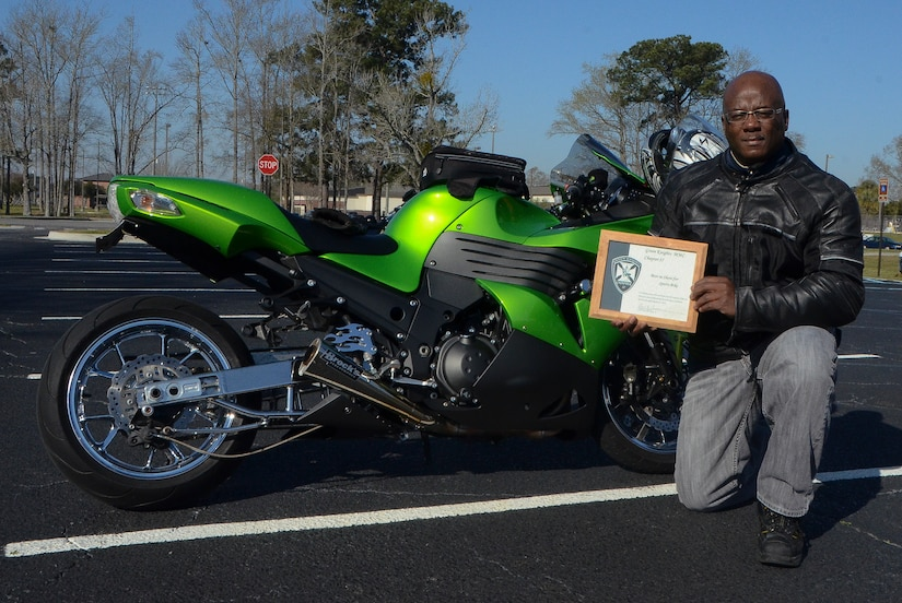 Technical Sgt. Robert Porter, 315th Aircraft Maintenance Squadron crew chief, displays his award for the best-in-show sport bike March 15, 2013, at the Joint Base Charleston – Air Base. More than 200 Airmen, Sailors, Soldiers, civilians and dependents from JB Charleston participated in the 2013 Joint Base Charleston Motorcycle Safety Rodeo throughout the Lowcountry. (U.S. Air Force photo/Airman 1st Class Jared Trimarchi)