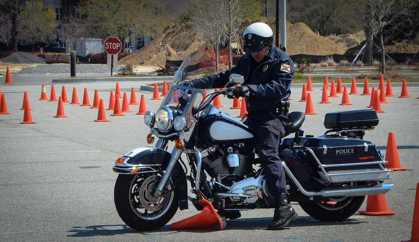 A deputy sheriff runs over a traffic cone during the Eighth Annual Palmetto  Police Motorcycle Rodeo March 15, 2013, at the North Charleston Coliseum. The event was part of the 2013 Joint Base Charleston Motorcycle Safety Rodeo. More than 200 Airmen, Sailors, Solders, civilians and dependents participated alongside more than 25 deputy sheriffs from South Carolina, Georgia and Florida. The Rodeo consisted of obstacle courses designed to tests the limits of a motorcycle and the handling skills of the operators. (U.S. Air Force photo/Airman 1st Class Jared Trimarchi)