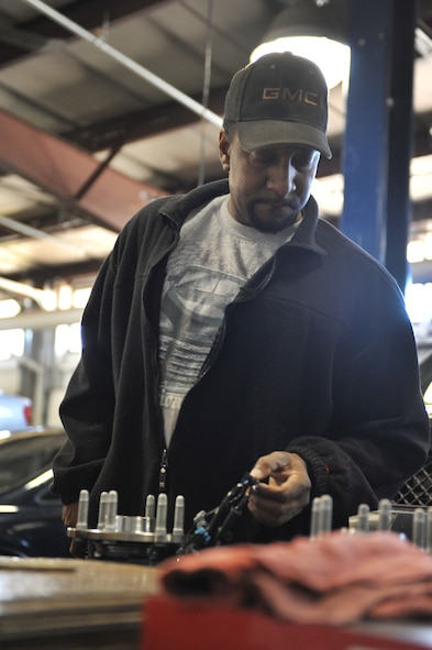 James Bell, an aviation electronics technician, prepares to replace the hubs on a truck at Spirit Auto, Whiteman Air Force Base, Mo., March 13, 2013. Spirit Auto offers an array of automotive services for Team Whiteman members. (U.S. Air Force photo by Heidi Hunt/Released)
