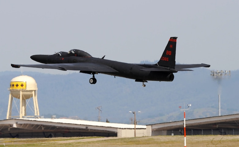 "A U-2 ""Dragon Lady"" takes off from Beale Air Force Base, Calif., March 15, 2013. U-2 pilots train at Beale using two-seat aircraft before deploying for operational missions. The four black crosses on the tower in the background represent four WWI offensives in which squadrons later assigned to the 9th Wing participated. (U.S. Air Force photo by Airman 1st Class Bobby Cummings/Released"