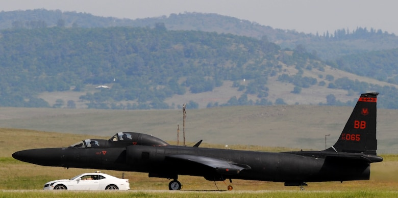 "A U-2 ""Dragon Lady"" prepares to take off as a chase car trails the aircraft on Beale Air Force Base, Calif., March 15, 2013. Chase cars travel at high speeds along the runway to guide the aircraft during takeoffs and landings.(U.S. Air Force photo by Airman 1st Class Bobby Cummings/Released)"