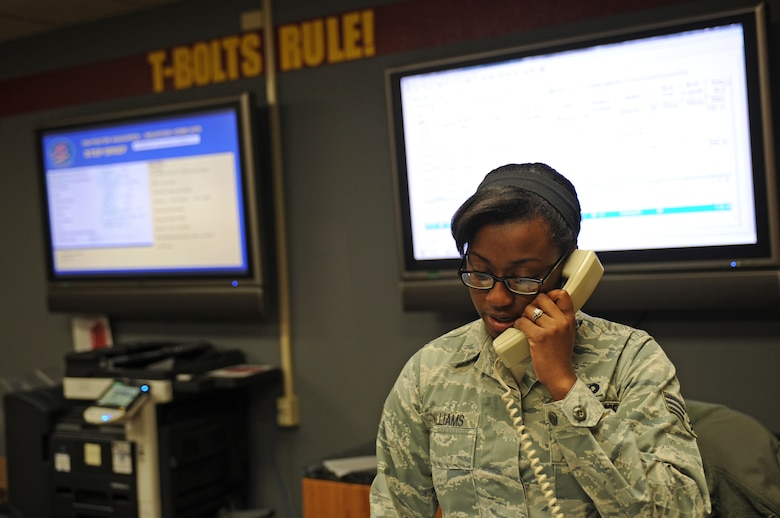 U.S. Air Force Senior Airman Casiana Curry-Williams, 389th Fighter Squadron aviation resource manager, mans the operations desk of the 389th FS March 18, 2013, at Mountain Home Air Force Base, Idaho. Squadron aviation resource managers are responsible for ensuring everything and everyone is ready for the daily flying missions. (U.S. Air Force photo/Senior Airman Benjamin Sutton)