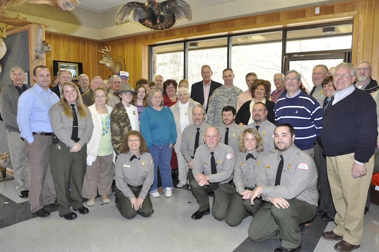 U.S. Army Corps of Engineers Nashville District personnel at Lake Cumberland unveil an honorary display wall March 13, 2013 to commemorate the service of park rangers during a ceremony at the Lake Cumberland Visitor's Center.  Current and former park rangers, employees, family members and friends commemorated the service of park rangers over the decades as environmental regulators and guardians of historic lands.