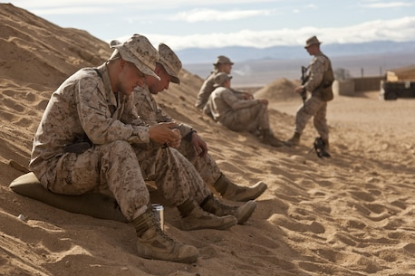 U.S. Marines with weapons company, 1st Battalion, 4th Marines, 5th Marine Regiment, take a break while waiting to depart during Exercise Steel Knight on Marine Corps Air-Ground Combat Center Twentynine Palms, Calif., Nov. 29, 2012. Exercise Steel Knight is an annual training exercise held to demonstrate the 1st Marine Division's abilities in a simulated combat scenario. (U.S. Marine Corps photo by Cpl. Jonathan R. Waldman/Released)