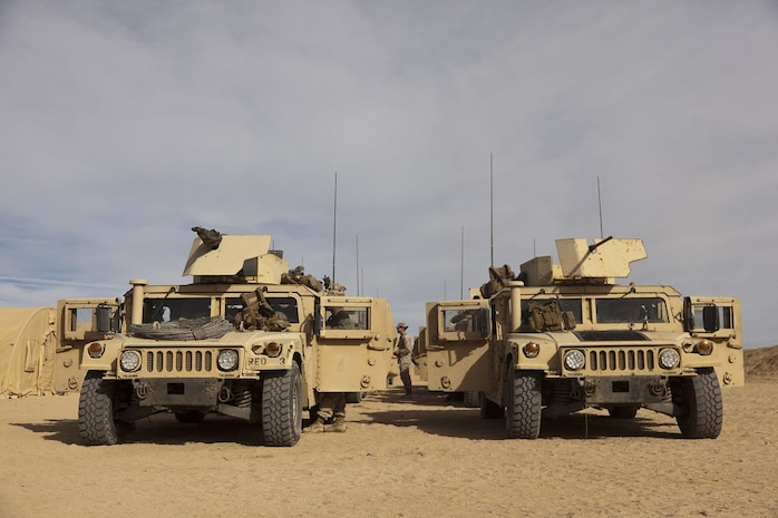 A convoy of Humvees sit ready to depart during Exercise Steel Knight on Marine Corps Air-Ground Combat Center Twentynine Palms, Calif., Nov. 27, 2012. Exercise Steel Knight is an annual training exercise held to demonstrate the 1st Marine Division's abilities in a simulated combat scenario. (U.S. Marine Corps photo by Cpl. Jonathan R. Waldman/Released)