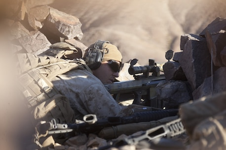 U.S. Marine Corps Lance Cpl. Kyle Janssen, assistant team leader with scout sniper team 1, scout sniper platoon, 1st Battalion, 4th Marines , 5th Marine Regiment, fires his XM107 Sniper Rifle during range 401 on Marine Corps Air Ground Combat Center Twentynine Palms, Calif., Dec. 4, 2012. Range 401 is a company maneuver and fire exercise held as part of Exercise Steel Knight. Exercise Steel Knight is an annual training exercise held to demonstrate the 1st Marine Division's abilities in a simulated combat scenario. (U.S. Marine Corps photo by Cpl. Jonathan R. Waldman/Released)