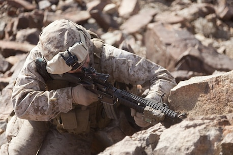 U.S. Marine Corps Cpl. Richard Rosales, a rifleman with 2nd platoon, Company A, 1st Battalion, 4th Marines, 5th Marine Regiment, fires his M-16A4 Assault Rifle during range 410 on Marine Corps Air Ground Combat Center Twentynine Palms, Calif., Dec. 1, 2012. Range 410 is a platoon fire and maneuver exercise held as part of Exercise Steel Knight. Exercise Steel Knight is an annual training exercise held to demonstrate the 1st Marine Division's abilities in a simulated combat scenario. (U.S. Marine Corps photo by Cpl. Jonathan R. Waldman/Released)