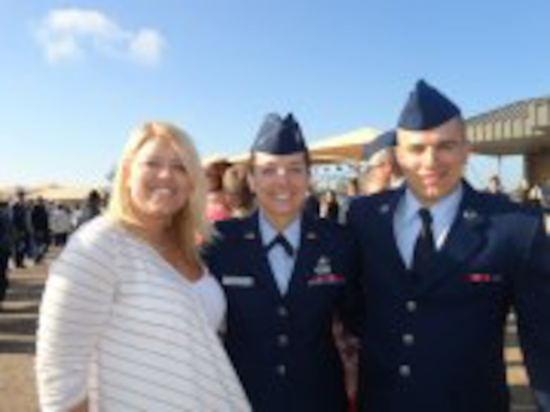 JBSA-SAN ANTONIO -- 2nd Lt. Kaylee Ausbun, 30th Space Wing Public Affairs deputy chief, stands with her older sister, Anna, and her younger brother, Amn. Caleb Hay on the parade grounds here Friday, March 15, 2013. Ausbun and her family spent the weekend in San Antonio celebrating Airman Hay's graduation. (U.S. Air Force by/ 2nd Lt. Kaylee Ausbun)