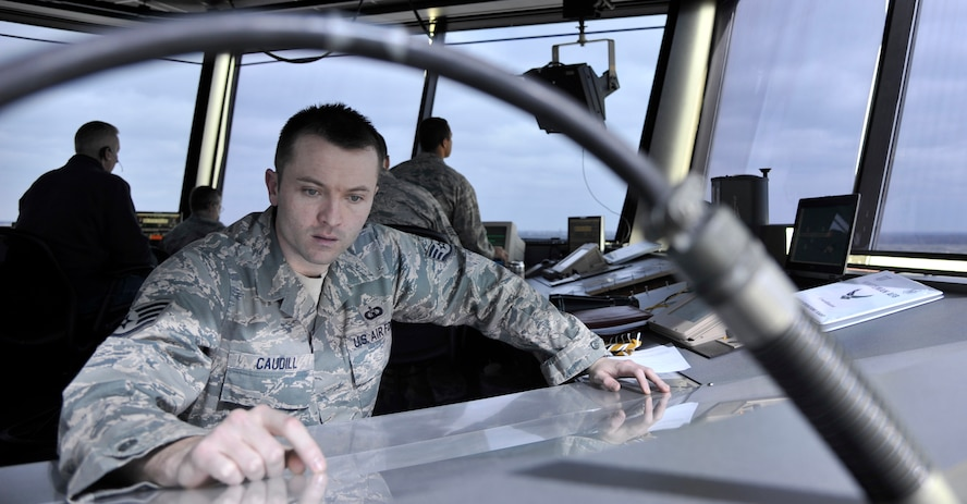 Staff Sgt. Blaine Caudill, 509th Operations Support Squadron air traffic control watch supervisor, reviews a crash grid map at Whiteman Air Force Base, Mo., March 11, 2013. In the event of an aircraft crash, the map is used to provide a detailed location of the crash site. (U.S. Air Force photo by Airman 1st Class Keenan Berry/Released)