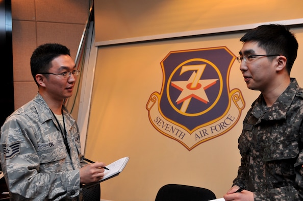 U.S. Air Force Staff Sgt. Hyo K. Oh and Republic of Korea Air Force 1st Lt. Lee, Suk-Hyung, 7th Air Force Air Component Command plans and coordination directorate senior interpreters, converse after a briefing during Exercise Key Resolve at Osan Air Base, Republic of Korea, March 20, 2013. Training exercises like Key Resolve are carried out in the spirit of the 1953 ROK-U.S. Mutual Defense Treaty. These exercises highlight the longstanding partnership and enduring friendship between the United Nations Command sending state nations, help ensure peace and security on the peninsula, and reaffirm the U.S. commitment to the region. (U.S. Air Force photo/Airman 1st Class Hailey R. Davis)