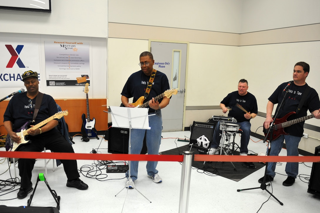 """Vets in Tune play """"Mustang Sally"""" by Mack Rice during a performance March 15, 2013, in the food court area at The Exchange on Buckley Air Force Base, Colo.  The band of veterans played 16 songs ranging from blues and rhythm to rock and pop during the lunchtime performance.  (U.S. Air Force photo by Airman 1st Class Riley Johnson/Released)"""