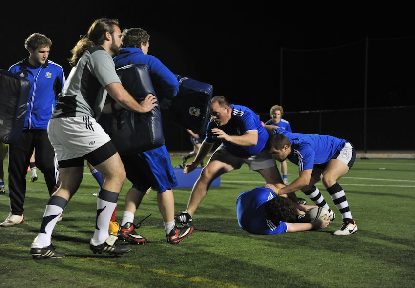 Jordan Winemiller, fourth from right, Kansas City Blues Rugby Club player, braces for a tackle during practice in Kansas City, Mo., March 14, 2013. As the only professionally-backed rugby sporting club in the country, the Blues expect its players to practice hard and play hard in all weather conditions. (U.S. Air Force photo by Senior Airman Brigitte N. Brantley/Released)