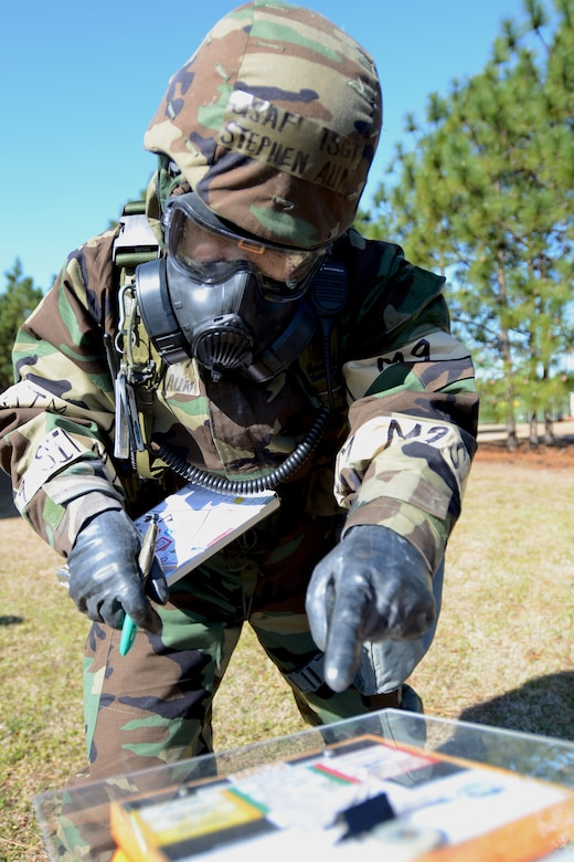 U.S. Air Force Tech. Sgt. Stephen Aun, with the 169th Communications Flight at McEntire Joint National Guard Base, S.C., inspects a chemical contamination stanchion during a post attack reconnaissance (PAR) check, March 15, 2013, after a simulated attack. PAR teams are designated for specific buildings and areas of the base to assess damage and survey the area for casualties, unexploded ordinances and chemical contamination after an attack. Personnel at McEntire are preparing for an upcoming Operational Readiness Inspection, which evaluates a unit's ability to operate and launch missions in a chemical combat environment. (National Guard photo by Tech. Sgt. Caycee Watson/Released)
