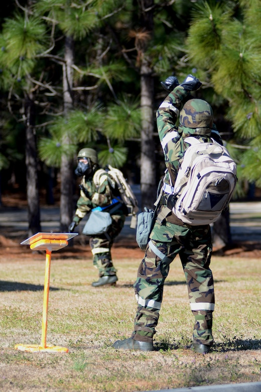 U.S. Air Force personnel with the 169th Fighter Wing at McEntire Joint National Guard Base, S.C., making up a three-person post attack reconnaissance (PAR) team, inspects the area surrounding a facility on base, March 15, 2013, after a simulated attack. A PAR team is designated for specific buildings and areas of the base to assess damage and survey the area for casualties, unexploded ordinances and chemical contamination after an attack. Personnel at McEntire are preparing for an upcoming Operational Readiness Inspection, which evaluates a unit's ability to operate and launch missions in a chemical combat environment. (National Guard photo by Tech. Sgt. Caycee Watson/Released)