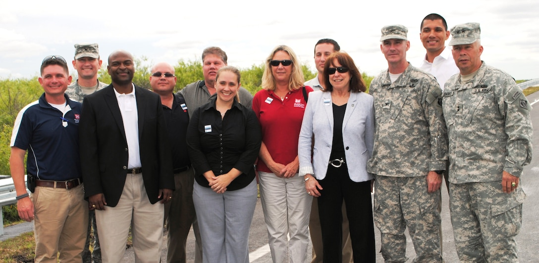 Assistant Secretary of the Army for Civil Works Jo-Ellen Darcy (fourth from right) celebrated the completion of a critical project milestone for the Tamiami Trail Modifications project alongside members of the U.S. Army Corps of Engineers team at the Tamiami Trail One-Mile Bridge Opening Ceremony March 19, 2013, in Miami, Fla. (From left: Chris Rego, South Atlantic Division Commander Col. Donald E. (Ed) Jackson, Tim Brown, Nestor Rivera, David Hobbie, Shealy Bowell, Kim Taplin, Michael Collis, Darcy, Jacksonville District Commander Col. Alan Dodd, Howie Gonzales and USACE Deputy Commanding General Maj. Gen. Todd Semonite).