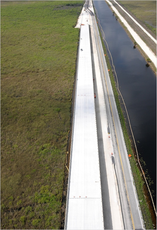 In addition to constructing the one-mile bridge, 9.7 miles of roadway will be modified to allow for increased water levels in the L-29 Canal that will flow beneath the bridge. Seventy-five percent of the roadway has been completed, and the Tamiami Trail Modifications project is scheduled to be completed by the end of the year.