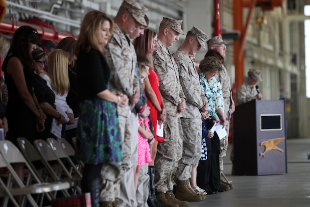Marines, sailors and ther families bow their heads during an invocation during Marine All-Weather Attack Squadron 533's change of command ceremony, March 11. During the ceremony, Lt. Col. Branden G. Bailey relinquished command of the squadron to Lt. Col. Kevin T. O'Rourke. O'Rourke will command the squadron as they prepare for an upcoming deployment.