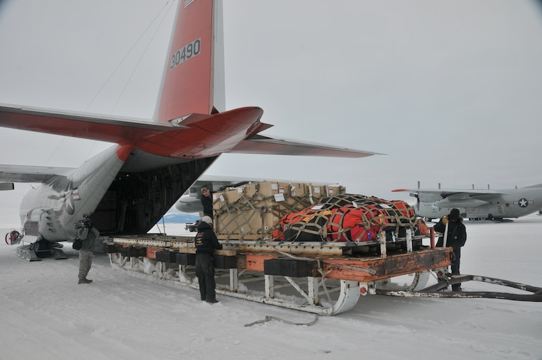 Civilian personnel work side by side with military members from the 109th Airlift Wing at McMurdo Station, Antarctica on December 15th 2012, as they load cargo onto an LC-130 Skibird bound for remote camps. (USAF Photo by SrA Ben German/Released)