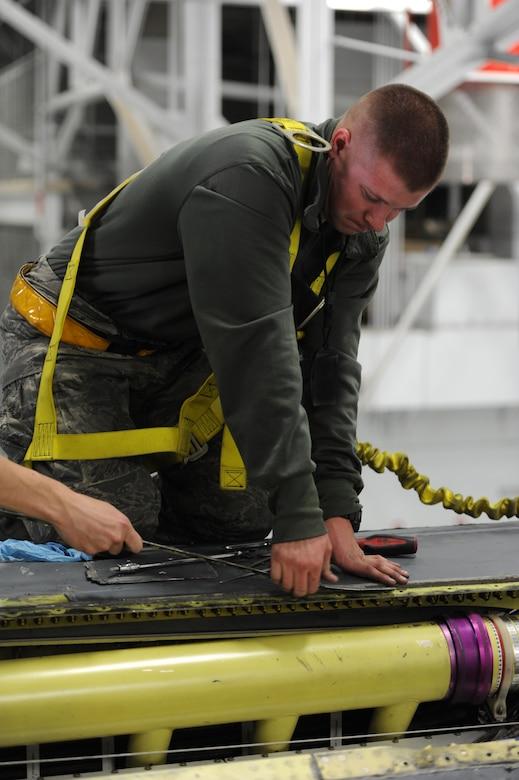 Senior Airman Bobby Haworth, 28th Aircraft Maintenance Squadron crew chief, removes panels from a B-1 for a Non-Destructive Inspection during the recent Operational Readiness Exercise at Ellsworth Air Force Base, S.D., March 19, 2013. Airmen in a variety of non-aviation roles conducted a broad range of active, hands-on training spanning a myriad of tasks to ensure the success of B-1 missions. (U.S. Air Force photo by Airman 1st Class Hrair H. Palyan/Released)