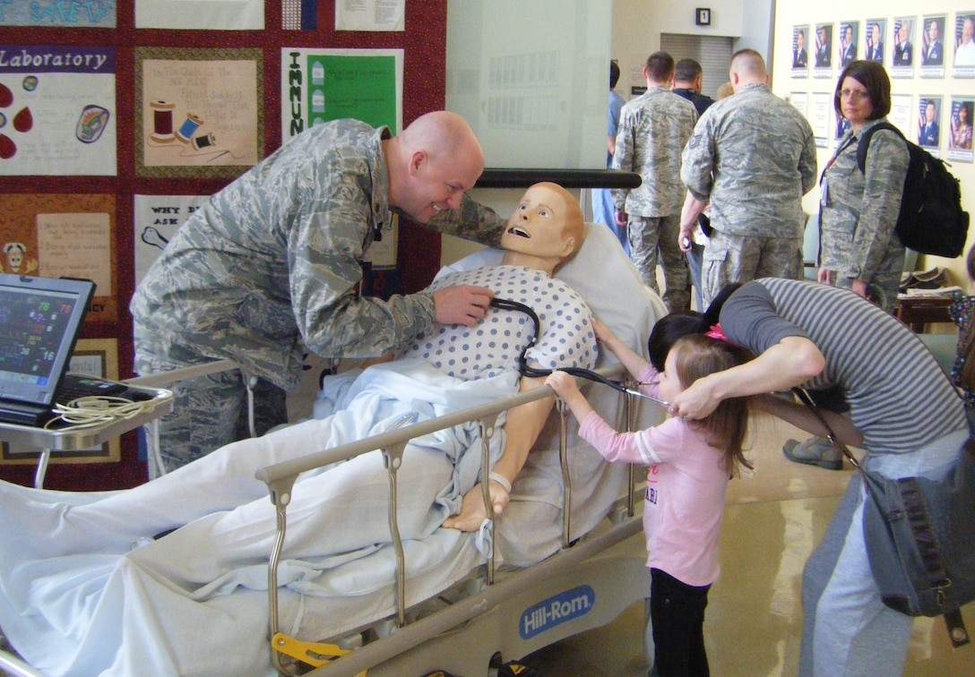 U.S. Air Force Maj. Kevin Skaggs, 366th Medical Group Director of Education Training, uses an emergency simulator to perform a safety demonstration for bystanders during National Patient Safety Awareness Week, March 13, 2013, at Mountain Home Air Force Base, Idaho. This is the eighth consecutive year the MDG has participated in the National Patient Safety Foundation's Annual Educational and Awareness Campaign for Healthcare Safety. (U.S. Air Force photo/Marcia Vondran Lutz)
