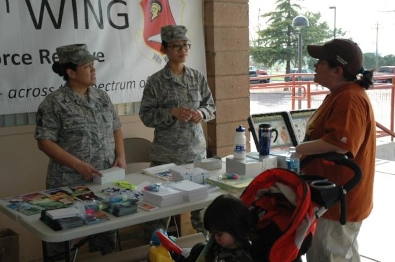 SMSgt Havens (left) explains the benefits of a drug free lifestyle during a health fair at her sons' school March 19. SMSgt Havens was asked to attend the fair to help educate parents and students about drug and alcohol abuse prevention. (U.S. Air Force Photo/Dana Lineback)