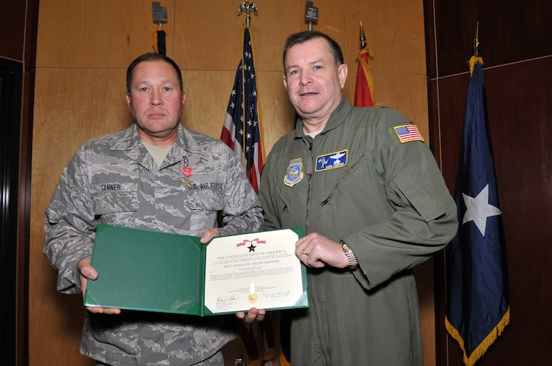 Master Sergeant Vince Tanner, from the 130th Engineering Installation Squadron, posed with Brig. Gen. David Fountain, the Assistant Adjutant General for Air, after receiving the Bronze Star medal. For deployment achievements supporting Operation Enduring Freedom during 2011 and 2012, two Bronze Stars and 28 additional medals were awarded to 18 members of the 130 EIS during a ceremony at the Utah Air National Guard Base Jan. 6. (U.S. Air Force photo by Tech. Sgt. Jeremy Giacoletto-Stegall)(RELEASED)
