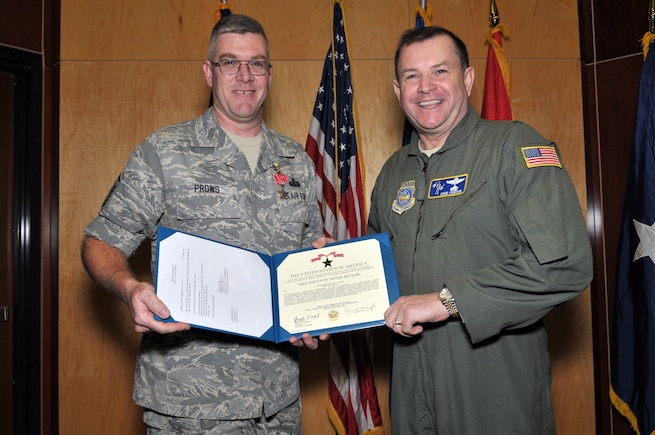 Master Sergeant Scott Prows, from the 130th Engineering Installation Squadron, posed with Brig. Gen. David Fountain, the Assistant Adjutant General for Air, after receiving the Bronze Star medal. For deployment achievements supporting Operation Enduring Freedom during 2011 and 2012, two Bronze Stars and 28 additional medals were awarded to 18 members of the 130 EIS during a ceremony at the Utah Air National Guard Base Jan. 6. (U.S. Air Force photo by Tech. Sgt. Jeremy Giacoletto-Stegall)(RELEASED)