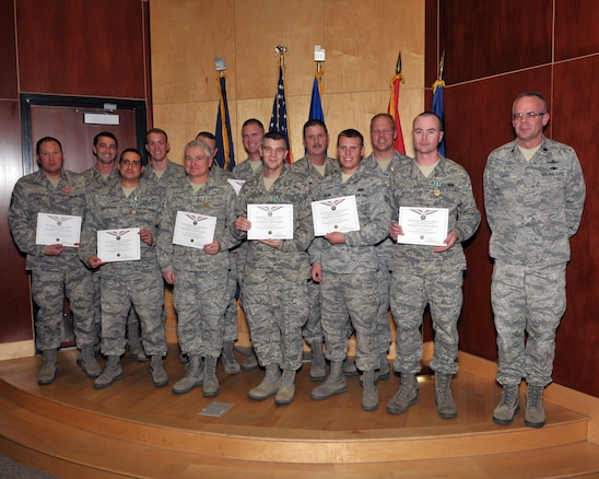 Members of the 130th Engineering Installation Squadron pose with their commander, Lt. Col. Kevin Tobias during an awards ceremony at the Utah Air National Guard Base Jan. 6. During the ceremony, 18 members of the 130th EIS were awarded two Bronze Star medals, 11 Army Commendation Medals, three Army Achievement Medals, two Air Force Achievement Medals (first oak leaf cluster) and 12 United States Afghanistan Campaign Medals for deployment achievements supporting Operation Enduring Freedom during 2011 and 2012. (U.S. Air Force photo by Tech. Sgt. Jeremy Giacoletto-Stegall)(RELEASED)