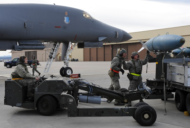 (From left to right) Senior Airman Stefen Ivanovic, Senior Airman Josh Jenkins and Airman 1st Class Caleb Burker, 28th Aircraft Maintenance Squadron weapons load crew members, unload munitions from a B-1 bomber during an Operational Readiness Exercise at Ellsworth Air Force Base, S.D., March 20, 2013. The ORE exercised a wide range of unit operations, and tested Airmen's abilities to effectively deploy equipment, airmen and aircraft in response to global contingencies. (U.S. Air Force photo by Airman 1st Class Anania Tekurio/Released)